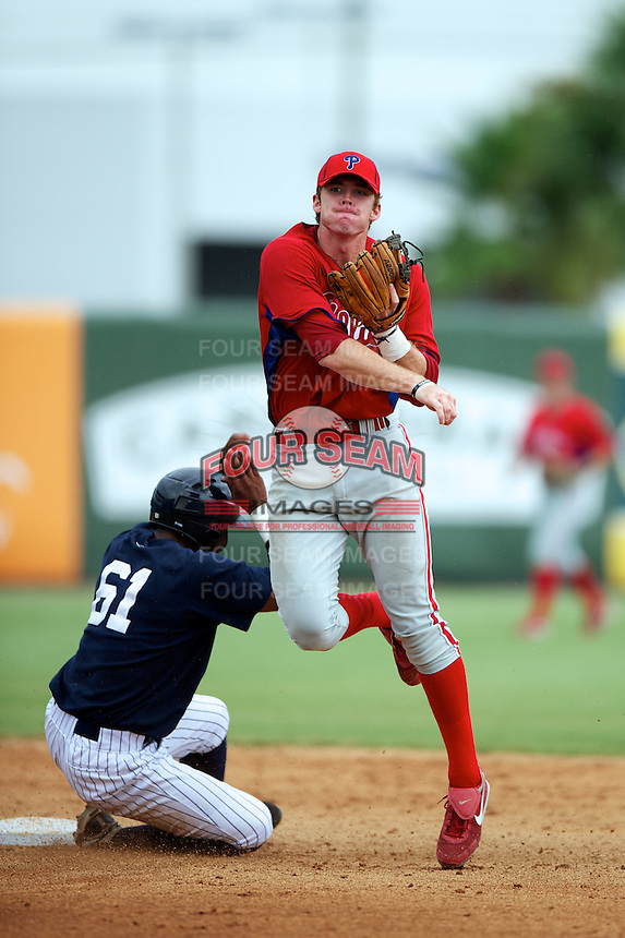 GCL Phillies Zach Green #12 attempts to turn a double play as Ericson Leonora #61 slides in during a Gulf Coast League game against the GCL Yankees at Legends Field on July 17, 2012 in Tampa, Florida.  GCL Phillies defeated the GCL Yankees 4-2.  (Mike Janes/Four Seam Images)