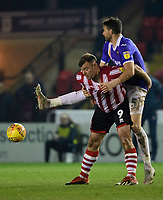 Lincoln City's Matt Rhead vies for possession with Exeter City's Aaron Martin<br /> <br /> Photographer Chris Vaughan/CameraSport<br /> <br /> The EFL Sky Bet League Two - Lincoln City v Exeter City - Tuesday 26th February 2019 - Sincil Bank - Lincoln<br /> <br /> World Copyright © 2019 CameraSport. All rights reserved. 43 Linden Ave. Countesthorpe. Leicester. England. LE8 5PG - Tel: +44 (0) 116 277 4147 - admin@camerasport.com - www.camerasport.com