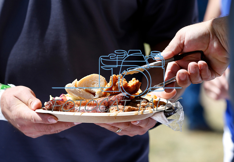 Attendees enjoy a traditional Basque lunch, including deep-fried lamb testicles, at the 4th annual Basque Fry in Gardnerville, Nev., on Saturday, Aug. 25, 2018. Hosted by the Morning in Nevada PAC, the event is a fundraiser for conservative candidates and issues. (Cathleen Allison/Las Vegas Review Journal)
