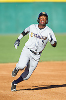 Miguel Andujar (5) of the Charleston RiverDogs hustles towards third base against the Hickory Crawdads at L.P. Frans Stadium on May 24, 2014 in Hickory, North Carolina.  The Crawdads defeated the RiverDogs 7-3.  (Brian Westerholt/Four Seam Images)