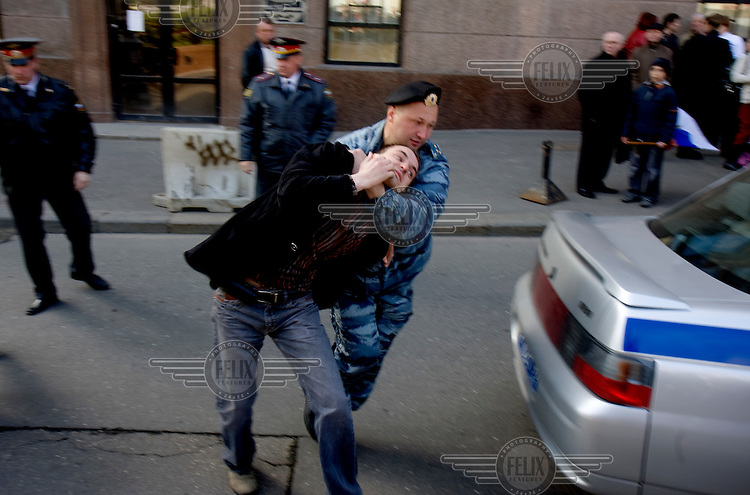 Police arrest a man during the Victory Day in Moscow, when Russians commemorate the Second World War. © Justin Jin