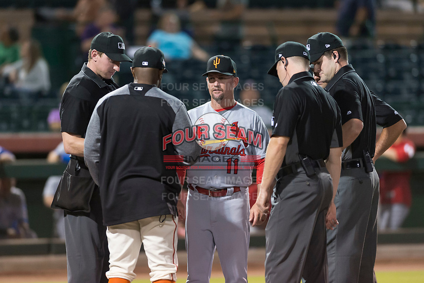 Surprise Saguaros manager Stubby Clapp (11) meets with Scottsdale Scorpions manager Willie Harris (22) and umpires Alex Tosi, Jeremy Riggs, Junior Valentine, and John Bacon before an Arizona Fall League game against the Scottsdale Scorpions at Scottsdale Stadium on October 15, 2018 in Scottsdale, Arizona. Surprise defeated Scottsdale 2-0. (Zachary Lucy/Four Seam Images)
