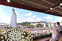 Pope Benedict XVI leads the traditional annual mass at Fatima's Sanctuary in Portugal on May 13, 2010. The mass marked the anniversary of the day in 1917 when three shepherd children reported to have seen the first of a series of apparitions of the Virgin Mary, turning the Portuguese village into one of the biggest draws for the Roman Catholic faithful.
