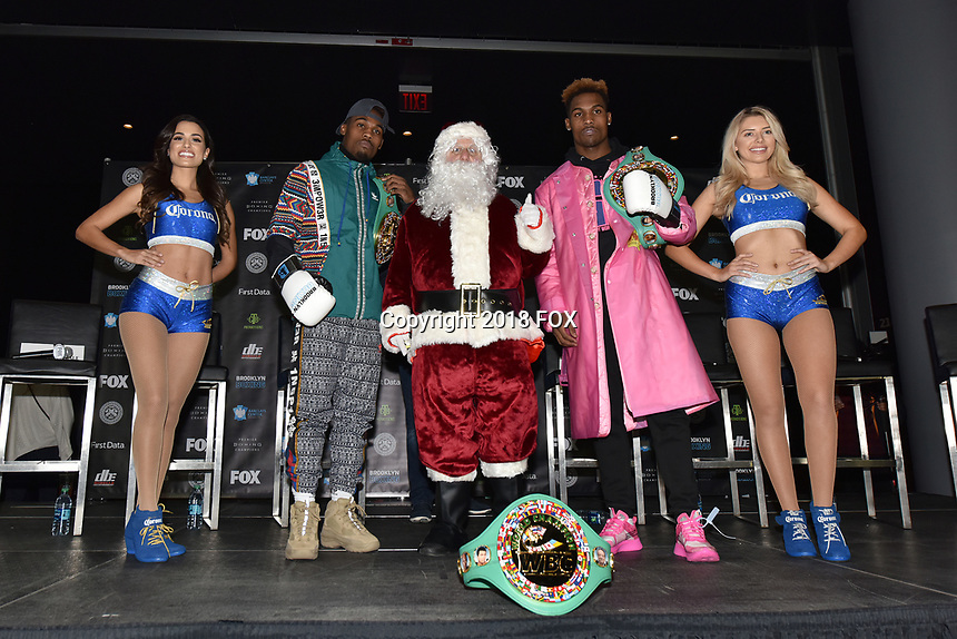 BROOKLYN, NY - DECEMBER 20: Boxers Jermell Charlo (second from left) and Jermall Charlo (second from right) pose with Santa Clause on stage during the Premier Boxing Champions press conference for the December 22 Fox PBC Fight Night at the Barclay Center on December 20, 2018 in Brooklyn, New York. (Photo by Anthony Behar/Fox Sports/PictureGroup)
