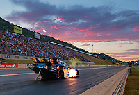 Jul 19, 2019; Morrison, CO, USA; NHRA funny car driver Shawn Langdon races at sunset during qualifying for the Mile High Nationals at Bandimere Speedway. Mandatory Credit: Mark J. Rebilas-USA TODAY Sports