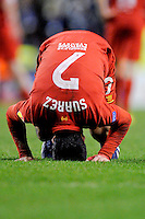 21.02.2013 Liverpool, England. Luis Suarez  of Liverpoo distraught on his haunches and head after the final whistle  in the Europa League game between Liverpool and Zenit St Petersburg from Anfield. Liverpool won 3-1 on the night but went out of the competition on away goals.