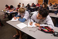 College students listen and take notes in a classroom in Belmont, NC.