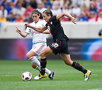 Abby Wambach (20) of the USWNT  tries to sprint past Alina Garciamendez (4) of Mexico during the game at Red Bull Arena in Harrison, NJ.  The USWNT defeated Mexico, 1-0.