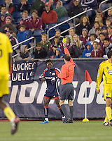 New England Revolution defender Emmanuel Osei (5) receives a yellow card warning. The Columbus Crew defeated the New England Revolution, 1-0, at Gillette Stadium on October 10, 2009.