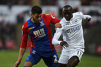 Modou Barrow of Swansea City FC (R) is challenged by Joel Ward of Crystal Palace FC during the Premier League match between Swansea City and Crystal Palace at The Liberty StadiumSwansea, Wales, UK. Saturday 26 November 2016