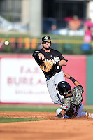 San Antonio Missions second baseman Casey McElroy (7) turns a double play as Brian Hernandez (12) slides in during a game against the Arkansas Travelers on May 25, 2014 at Dickey-Stephens Park in Little Rock, Arkansas.  Arkansas defeated San Antonio 3-1.  (Mike Janes/Four Seam Images)