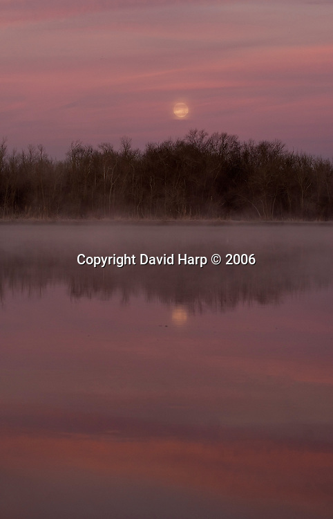 An early spring full moon sets over the Nanticoke River at sunrise