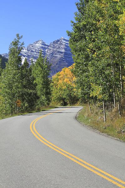 Maroon Creek Road with aspen trees leading to the Maroon Bells Peaks, near Aspen, Colorado, USA John offers fall foliage photo tours throughout Colorado.