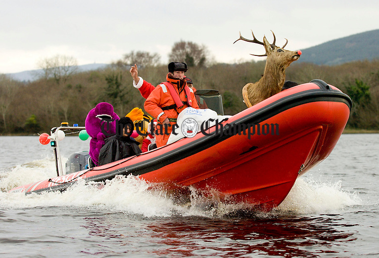 Santa and friends arriving at Scariff on the Mountshannon rescue boat.Pic Arthur Ellis.