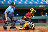 Catcher Cole Messina (25) of Summerville HS in Summerville, SC playing for the Arizona Diamondbacks scout team blocks a pitch in the dirt as home plate umpire Michael Kelley looks on during the East Coast Pro Showcase at the Hoover Met Complex on August 5, 2020 in Hoover, AL. (Brian Westerholt/Four Seam Images)