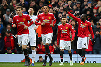 Romelu Lukaku of Manchester United celebrates scoring his sides first goal during the Premier League match between Manchester United and Swansea City at the Old Trafford, Manchester, England, UK. Saturday 31 March 2018