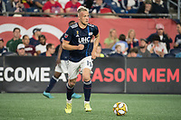 FOXBOROUGH, MA - SEPTEMBER 21: Antonio Mlinar Delamea #19 of New England Revolution brings the ball forward during a game between Real Salt Lake and New England Revolution at Gillette Stadium on September 21, 2019 in Foxborough, Massachusetts.
