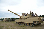 """American soldiers with Delta Company, 2nd Battalion, 7th Infantry Regiment, 1st Armored Brigade Combat Team, 3rd Infantry Division with M1A2 Abrams tanks after a tank training exercise practicing infiltration at the Drawsko Pomorskie Training Area in Poland on June 12, 2015.    NATO is engaged in a multilateral training exercise """"Saber Strike,"""" the first time Poland has hosted such war games, involving the militaries of Canada, Denmark, Germany, Poland, and the United States."""