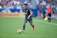 CARSON, CA - SEPTEMBER 29: Michaell Chirinos #33 of the Vancouver Whitecaps moves to the ball during a game between Vancouver Whitecaps and Los Angeles Galaxy at Dignity Health Sports Park on September 29, 2019 in Carson, California.