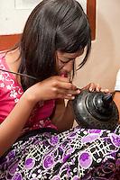 Myanmar, Burma. Bagan.  Lacquerware Workshop, Young Woman at Work.