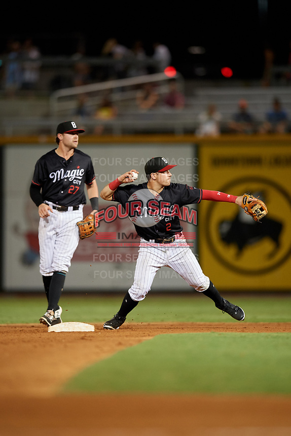 Birmingham Barons shortstop Danny Mendick (2) throws to first base to try to complete a double play as second baseman Trey Michalczewski (27) looks on during a game against the Tennessee Smokies on August 16, 2018 at Regions FIeld in Birmingham, Alabama.  Tennessee defeated Birmingham 11-1.  (Mike Janes/Four Seam Images)