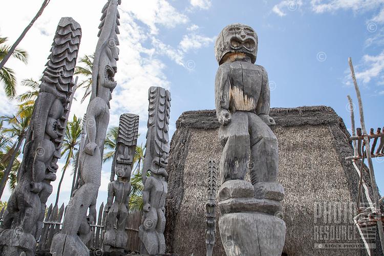 Ki'i or tiki (carved images) guard a recreated heiau or temple at Pu'uhonua o Honaunau, Hawai'i Island.