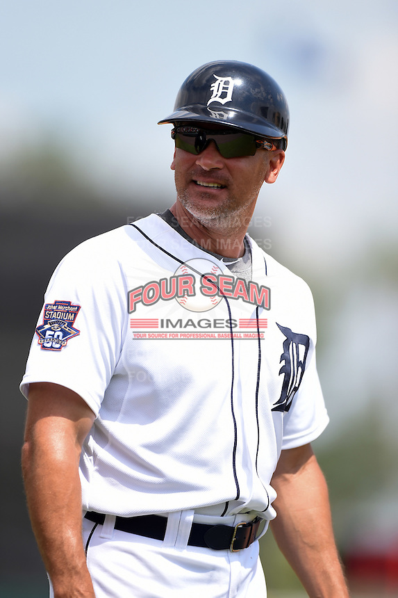 Detroit Tigers first base coach Omar Vizquel (15) during a Spring Training game against the Washington Nationals on March 22, 2015 at Joker Marchant Stadium in Lakeland, Florida.  The game ended in a 7-7 tie.  (Mike Janes/Four Seam Images)