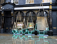 Despite the National Covid-19 Lockdown which has closed all non-essential shops till at least December 2nd, the famous luxury jewellers, Tiffany & Co have installed a neon light display in the shape of Christmas Trees outside their Old Bond Street store. November 20th 2020<br /> <br /> Photo by Keith Mayhew