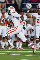 Louisiana Lafayette running back Elijah McGuire (15) runs for a touchdown during first half of an NCAA football game, Tuesday, October 14, 2014 in San Marcos, Tex. Louisana Lafayette leads 21-3 at the halftime. (Mo Khursheed/TFV Media via AP Images)