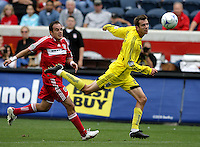 Columbus Crew midifielder Eric Brunner (23) head the ball back to his goalkeeper with Chicago Fire midfielder Cuauhtemoc Blanco (10) in pursuit.  The Columbus Crew tied the Chicago Fire 2-2 at Toyota Park in Bridgeview, IL on September 20, 2009.