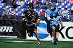 Face-Off Classic: Defensemen Rob Castelo # 4 of the Princeton Tigers defends Attackmen Marcus Holman #1 of the North Carolina Tar Heels during the Princeton v North Carolina mens lacrosse game at M&T Bank Stadium on March 10, 2012 in Baltimore, Maryland. (Ryan Lasek/Eclipse Sportswire)