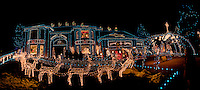 Holiday decorations and lights fill the front lawn and cover the house, even adorning the roof with reindeer and a sleigh in this panoramic image of a house in Broomfield, Colorado.