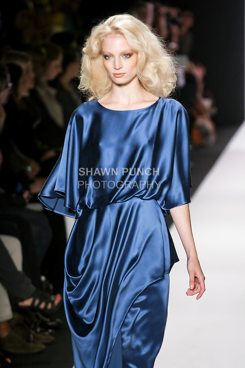 Model walks runway in an outfit by Fiona Cibani, for the Ports 1961 Spring 2011 Essadi Collection fashion show, during Mercedes-Benz Fashion Week, September 10, 2010.