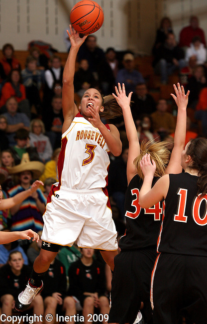 SIOUX FALLS, SD - JANUARY 12: Shaunteva Ashley #3 of Roosevelt takes the ball to the basket past Becca Ryan #34 and Jessica Carson #10 of Washington in the first half of their game Tuesday night at Roosevelt. (Photo by Dave Eggen/Inertia)