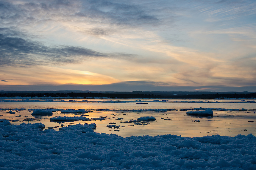The sun setting over an icy Lake Superior. Marquette, MI