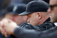 Wake Forest Demon Deacons trainer Jeff Strahm watches the action from the dugout during the game against the Notre Dame Fighting Irish at David F. Couch Ballpark on March 10, 2019 in  Winston-Salem, North Carolina. The Demon Deacons defeated the Fighting Irish 7-4 in game one of a double-header.  (Brian Westerholt/Four Seam Images)