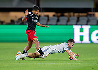 WASHINGTON, DC - MAY 13: Edison Flores #10 of D.C. United fouls Alvaro Medran #10 of Chicago Fire FC during a game between Chicago Fire FC and D.C. United at Audi FIeld on May 13, 2021 in Washington, DC.