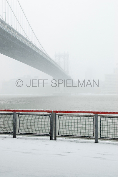 Manhattan Bridge and East River Viewed from East River Esplanade During a Snowstorm....Lower Manhattan, New York City, New York State, USA
