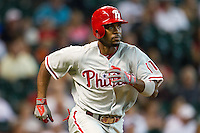 Philadelphia Phillies shortstop Jimmy Rollins #11 runs to first base during the Major League baseball game against the Houston Astros on September 16th, 2012 at Minute Maid Park in Houston, Texas. The Astros defeated the Phillies 7-6. (Andrew Woolley/Four Seam Images)..