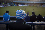Greenock Morton 2 Stranraer 0, 21/02/2015. Cappielow Park, Greenock. Home supporters in the Shed watching as Greenock Morton (in hoops) take on Stranraer in a Scottish League One match at Cappielow Park, Greenock. The match was between the top two teams in Scotland's third tier, with Morton winning by two goals to nil. The attendance was 1,921, above average for Morton's games during the 2014-15 season so far. Photo by Colin McPherson.