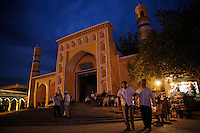 """Residents outside the venerated Idkah Mosque in the Kashgar old city, Xinjiang Province, China. Assailants armed with grenades and knives killed 16 police in Kashgar yesterday, it was a """"suspected terrorist"""" attack 4 days before the Olympics..04 Aug 2008"""