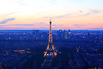 Twilight light aerial view of Eiffel Tower with area of Right Bank and La Défense in the background. City of Paris. Paris. France