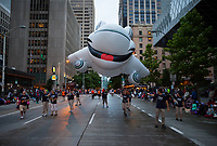 Alaska Airlines Plane Balloon Float, Seafair Torchlight Parade 2015, Seattle, Washington State, WA, America, USA.