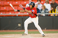 Leury Garcia #3 of the Hickory Crawdads follows through on his swing against the Greenville Drive at  L.P. Frans Stadium May 8, 2010, in Hickory, North Carolina.  Photo by Brian Westerholt / Four Seam Images