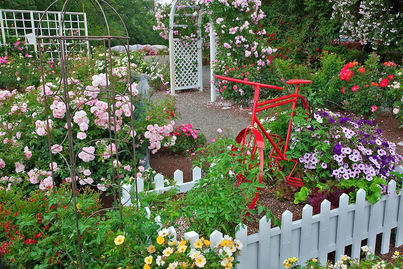 Red bike in garden display. Heirloom Gardens, St. Paul, Oregon.