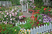 Red bike in garden display. Heirloom Gardens, St. Paul, Oregon.