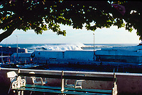 Line up from across the harbour of Mundaka river-mouth during an epic swell in November 1989. Mundaka, Basque Country, Spain. Photo: joliphotos.com