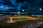 Baseball on a cloudy night in Fifth Third Field in Dayton Ohio at dusk.
