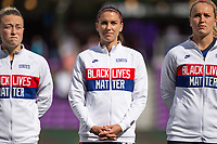 ORLANDO CITY, FL - FEBRUARY 21: Emily Sonnett #14, Alex Morgan #13, Lindsey Horan #9 of the USWNT stand for the National Anthem before a game between Brazil and USWNT at Exploria Stadium on February 21, 2021 in Orlando City, Florida.