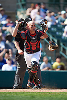 Rochester Red Wings catcher Eric Fryer (22) backs up a play during a game against the Norfolk Tides on May 3, 2015 at Frontier Field in Rochester, New York.  Rochester defeated Norfolk 7-3.  (Mike Janes/Four Seam Images)
